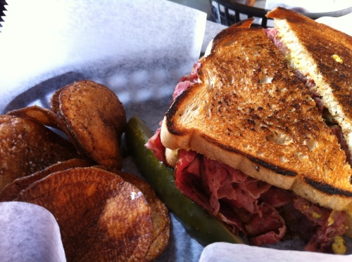 """The Pastramisseur"" house-smoked pastrami with brown mustard on rye."