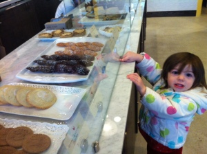 My daughter desperately requesting her second madeleine.