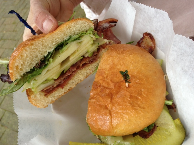 The ABC: cheddar cheese, granny smith apple, bacon and greens on a soft roll.