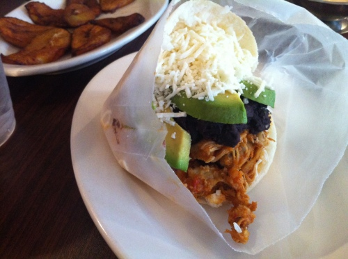 The chicken arepa with sliced avocado, black beans and cheese.
