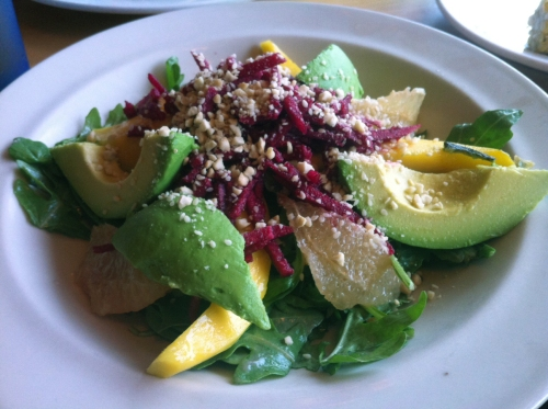 Reggie's Raw Heaven salad: ugula – Mango – Grapefruit – Avocado Beet Infused Jicama – Cashew Gamasio – Pomegranate Dressing