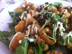 Point Judith Calamari: Lightly fried calamari with cherry peppers, tossed with arugula and fried capers, and topped with citrus aioli