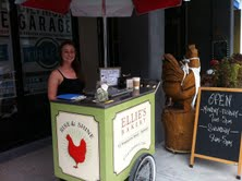 The ice cream cart is parked outside of Ellie's Bakery most days from noon til 5 pm.
