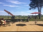 Newport Vineyards tables overlooking the grapevines.