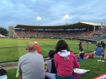 I love to sit on the grassy field by the outfield at McCoy Stadium.